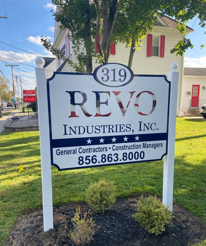 REVO Industries Inc. post and panel sign in daylight on front yard