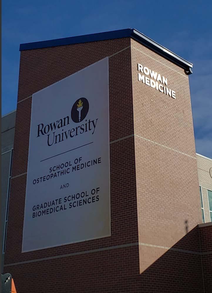 Rowan University Sign on side of brick walls