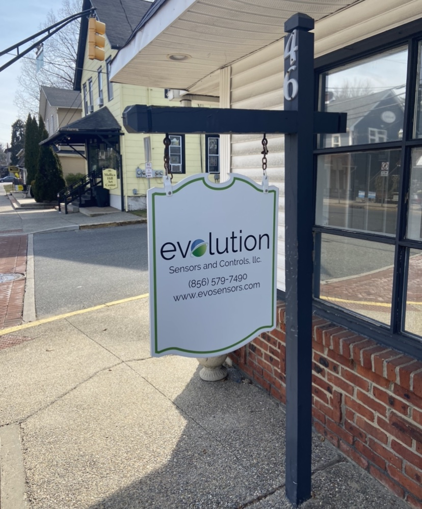 Evolution sign out front of store