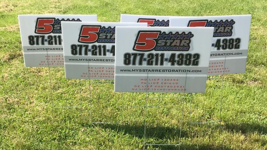 5 Star Restoration yard signs