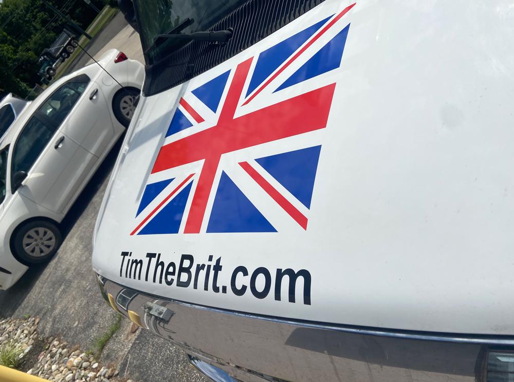 TimeTheBrit.com vehicle lettering on hood of car