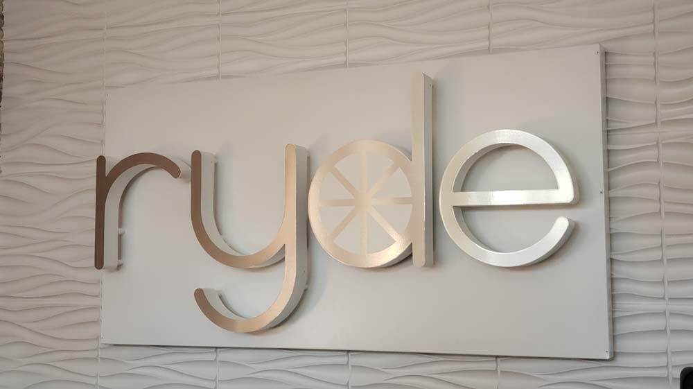 ryde sign on white patterned wall