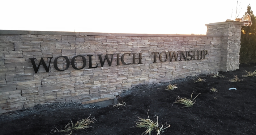 Woolwich Township sign on stone wall