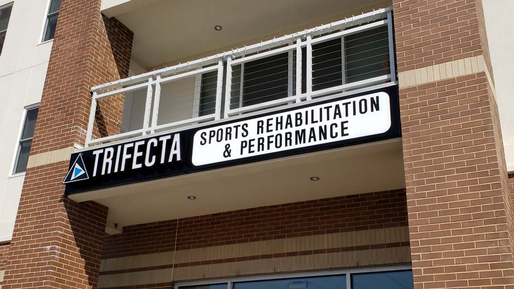 Trifecta sign on building
