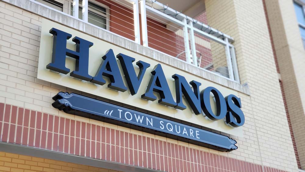 Havanos Town Square sign on building