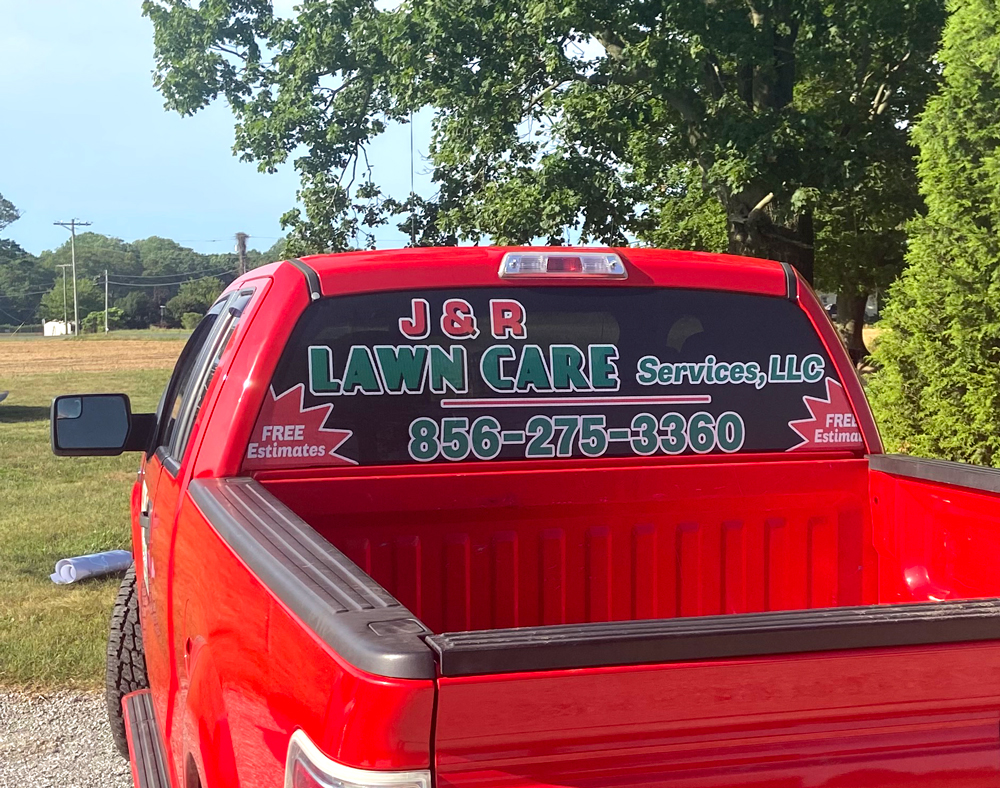 J & R vehicle lettering on red truck